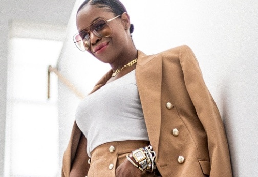 Style influencer Monica Awe-Etuk wearing high-fashion suit with her two-tone Deco watch in stainless and 18k gold along with several bracelets.