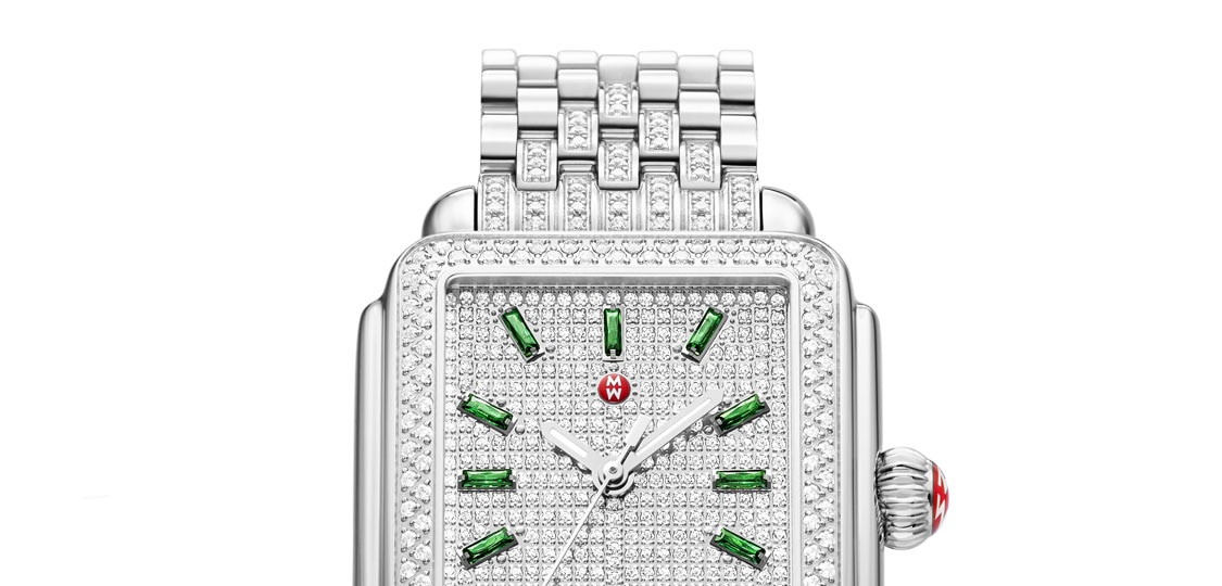 Limited-edition Deco watch featuring diamond-covered dial and emerald indexes.