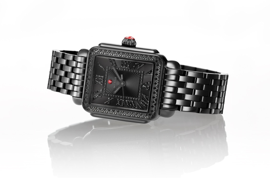 Deco Madison watch in all black featuring black diamond-covered Roman numeral indexes, seven-link bracelet and iconic red crown.