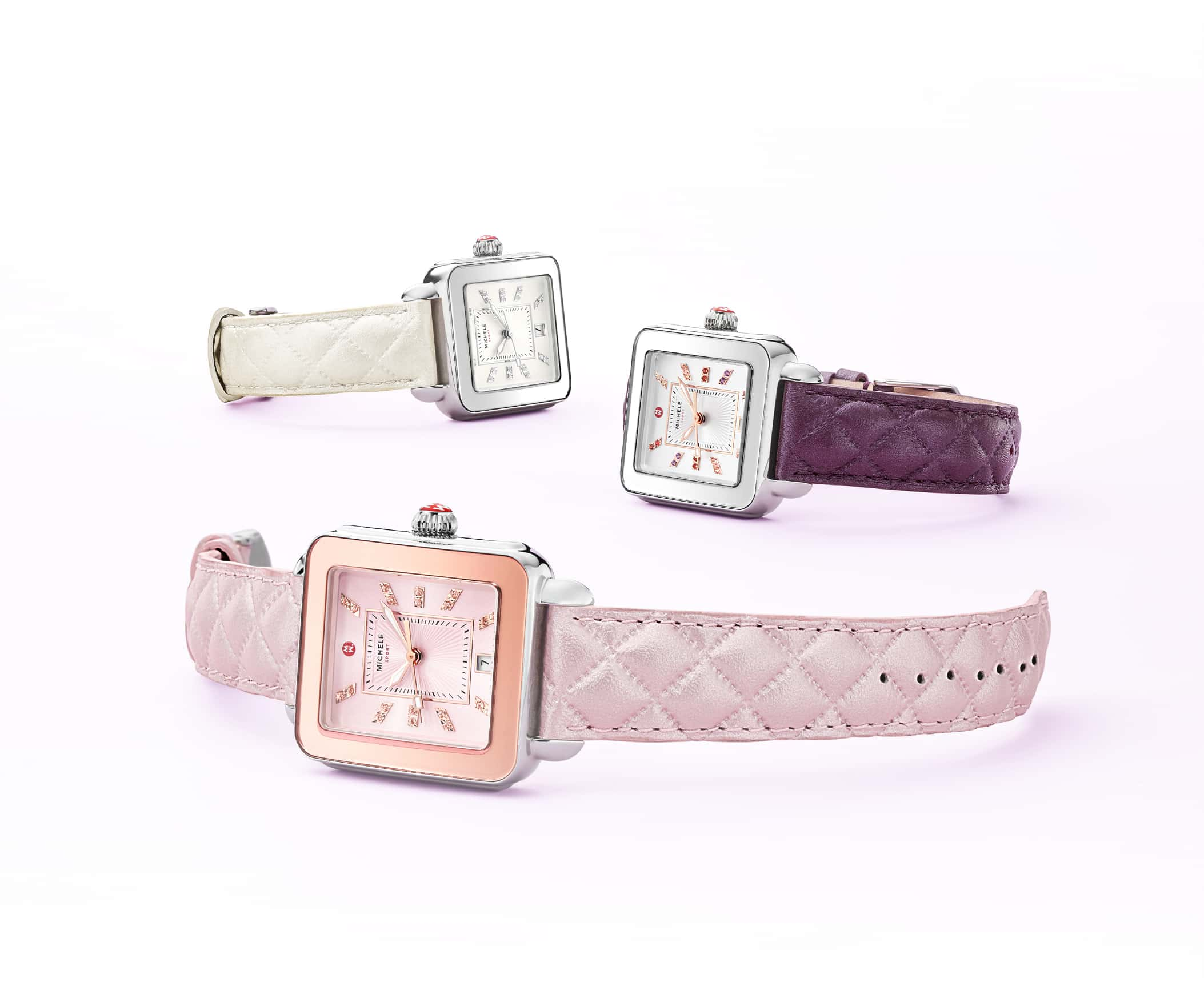 Three Deco Sport watches featuring sheen-finished quilted leather straps in lilac, violet and whtie and colorful topaz indexes.