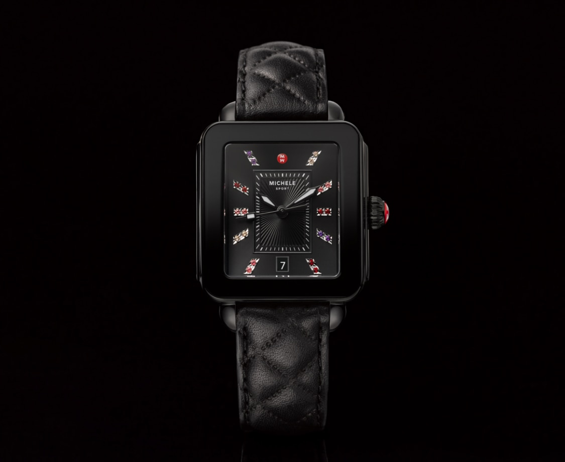 Deco sport watch featuring a rainbow of topaz indexes, black quilted leather strap and black dial.