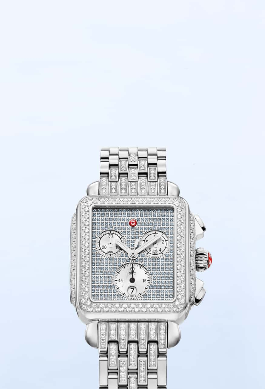 Limited-Edition Deco watch in sky featuring a sapphire-covered dial, diamond-covered bezel, lugs and stainless bracelet.