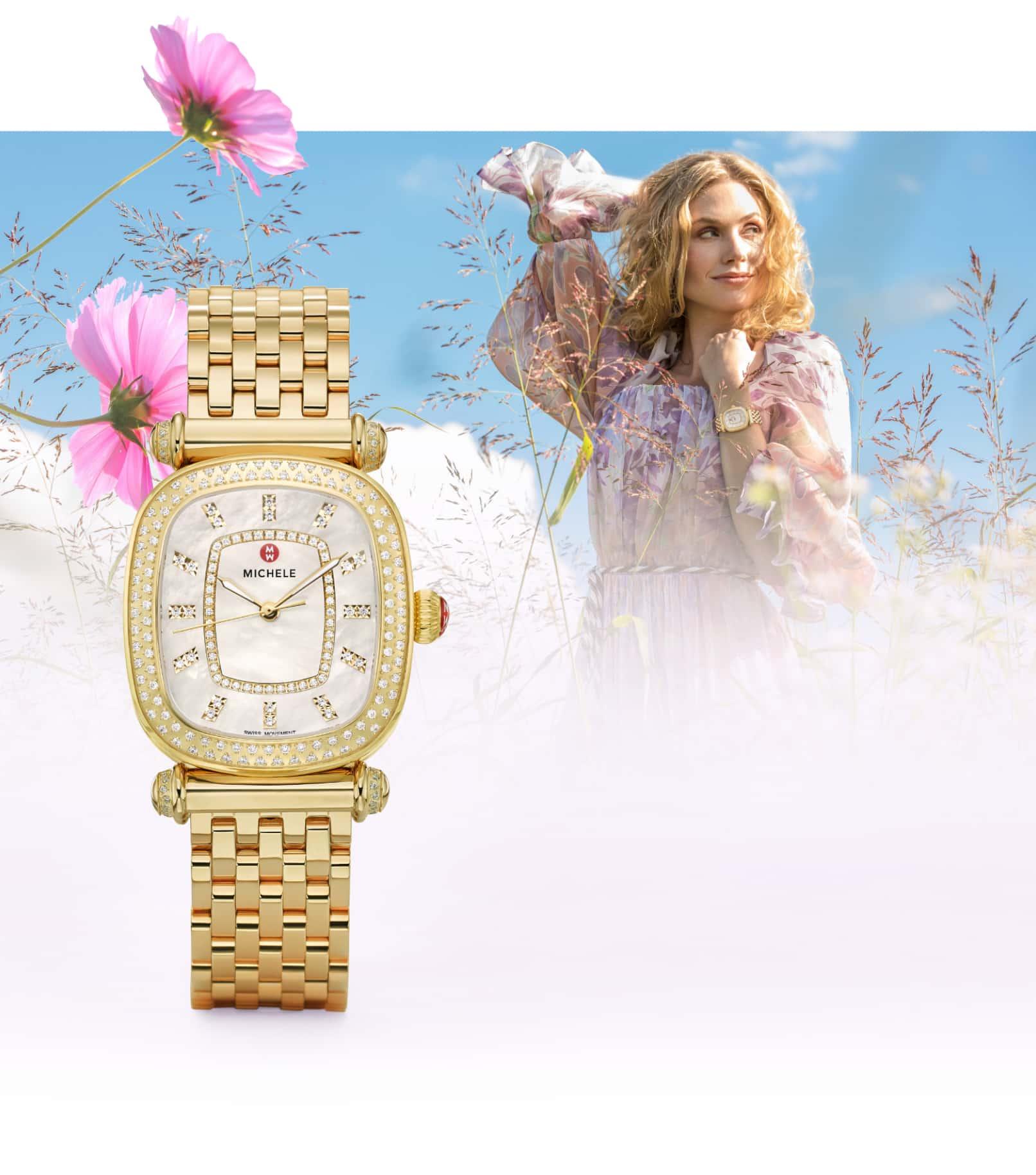 Stylish woman in field of flowers wearing 18K gold Caber Isle watch.