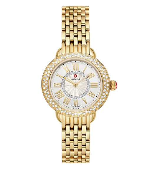Serein Mid watch in 18K gold featuring a diamond-covered bezel, round case and seven-link bracelet.