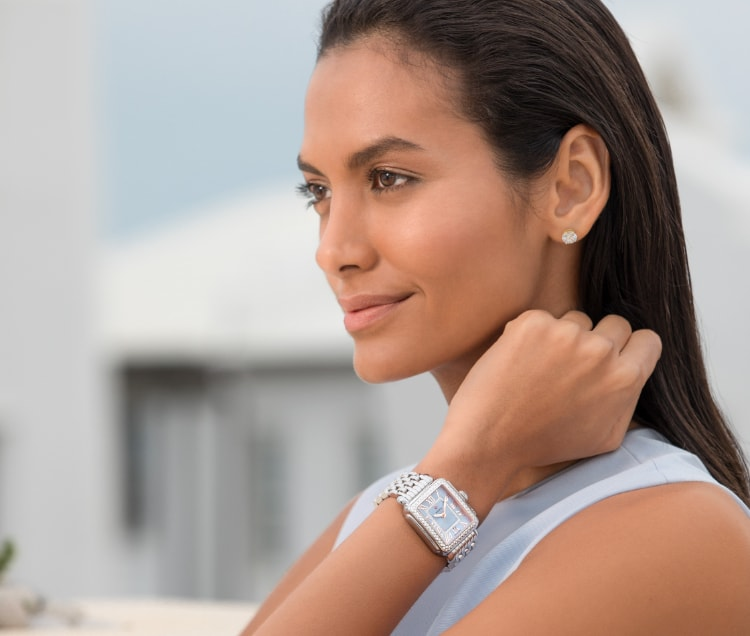 Sophisticated woman wearing stainless Deco watch with a sky blue dial.