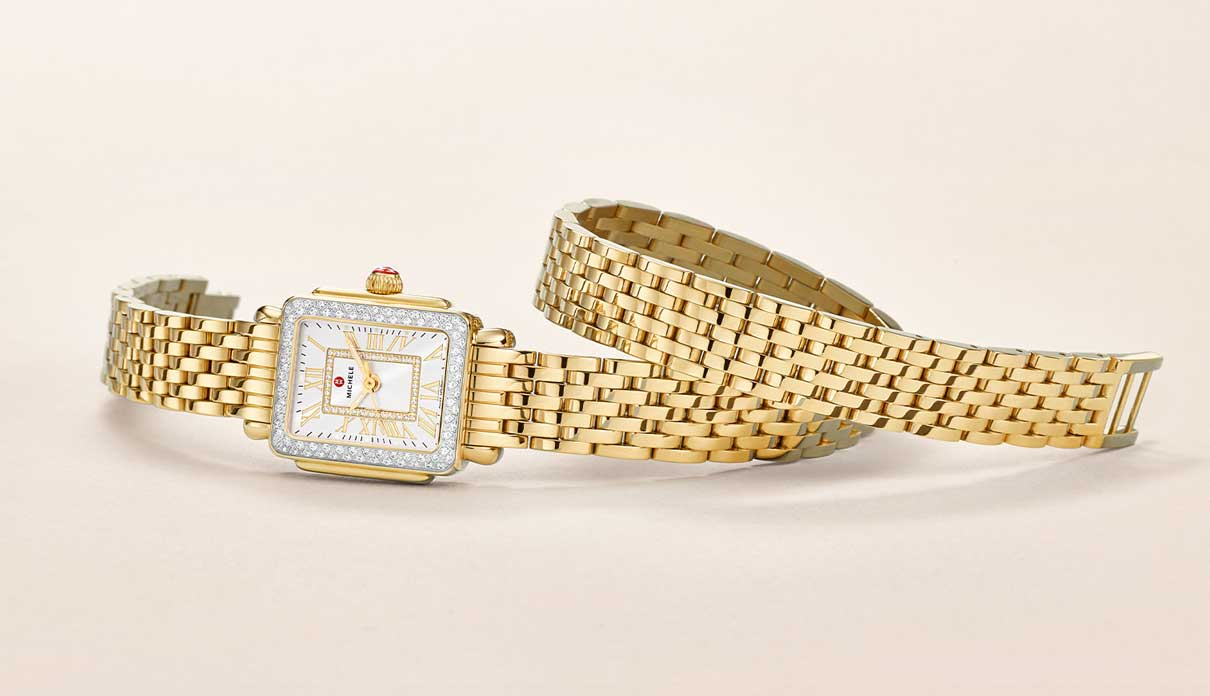 A double-wrap gold watch.