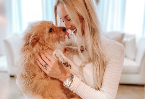 Style influencer Brittney Blane wearing cozy sweater along with her two-tone Deco watch in stainless and 18k pink gold.