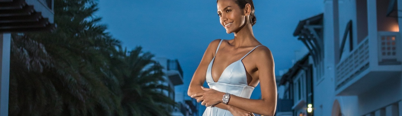 Sophisticated woman wearing sky blue gown and limited-edition Deco Sapphire watch.