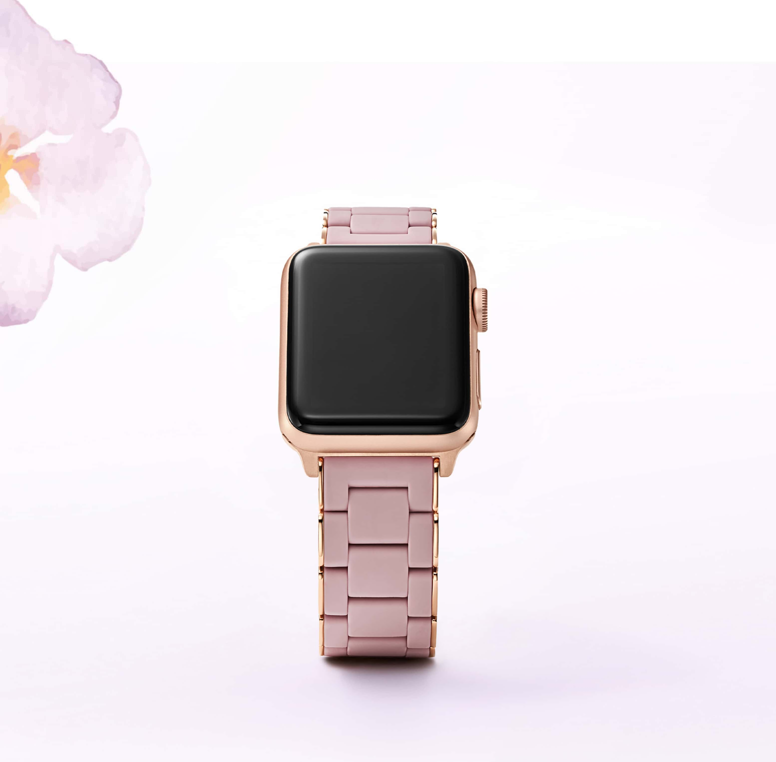 Silicone-wrapped band for Apple Watch® in rose and rose gold-tone.