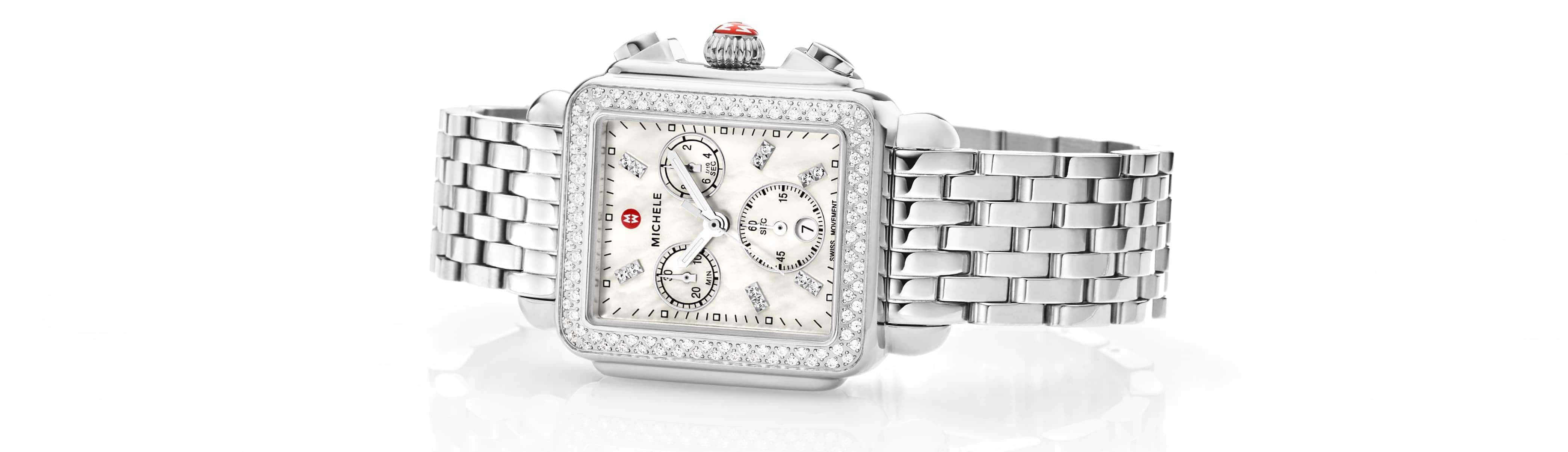 Sophisticated woman wearing the Deco watch while walking on the beach.