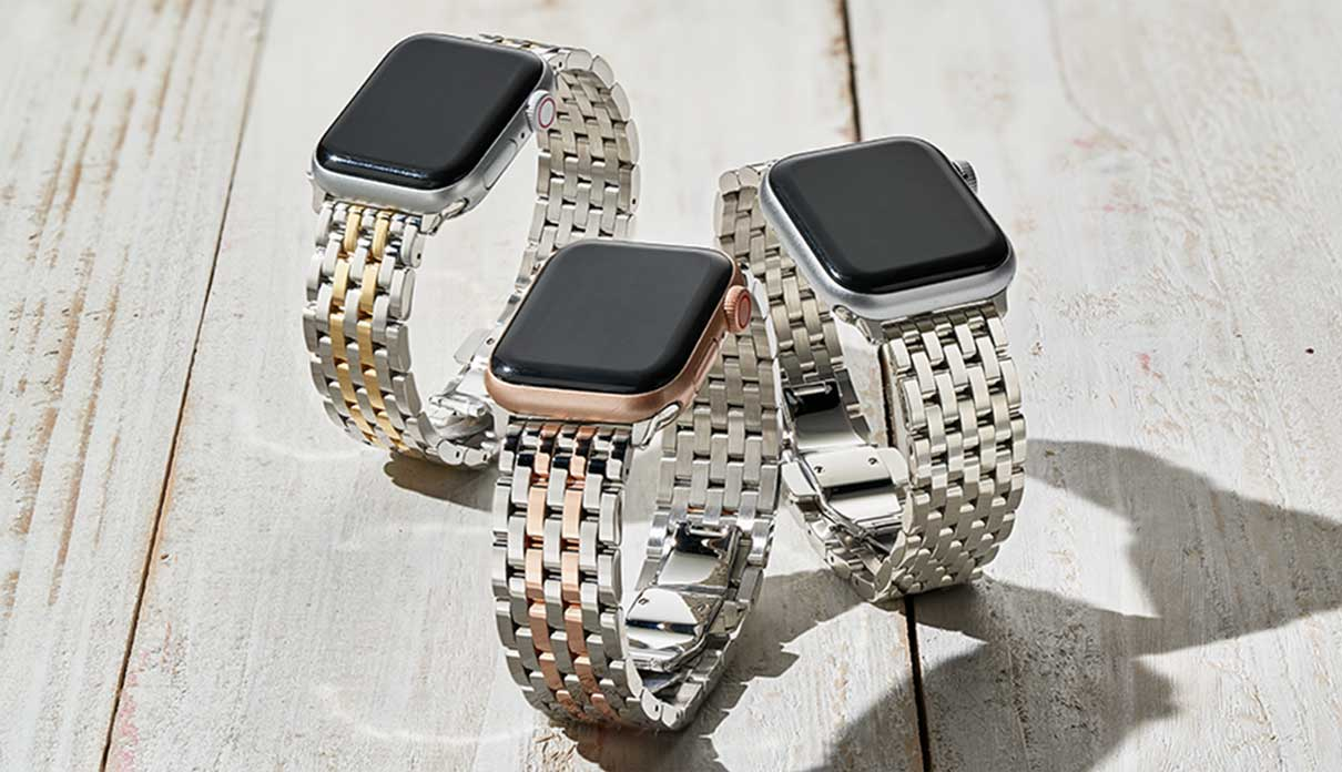 Three seven-link bracelet bands for Apple Watch® in two-tone stainless and 18k gold, two-tone stainless and 18k pink gold and stainless.
