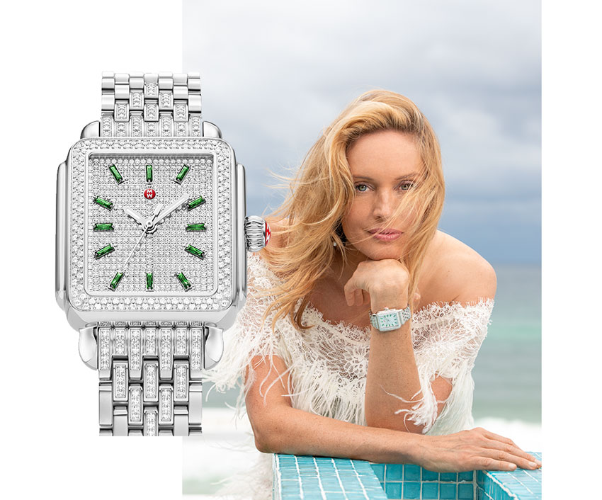 Elegant woman wearing gown on beach wearing the Deco Stainless Emerald and Pavé Diamond Watch.