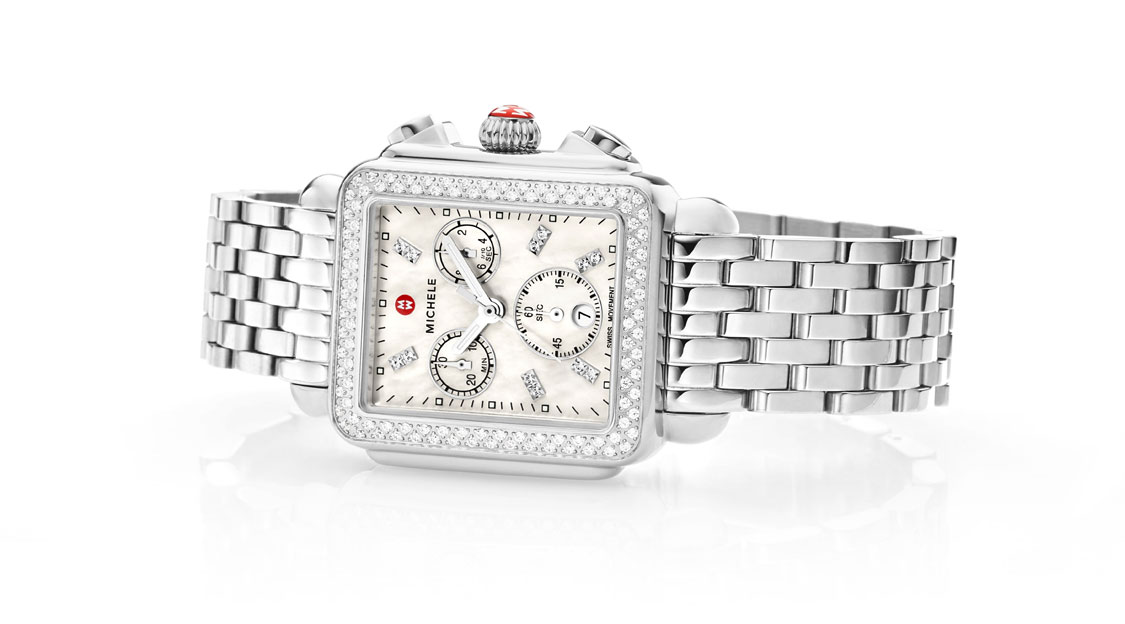 Deco watch in stainless featuring mother-of-pearl dial, diamond-coverd bezel and seven-link bracelet.