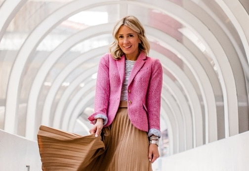 Style influencer Mireille Beckwith wearing colorful blazer and fashionable skirt with her Deco watch in stainless.